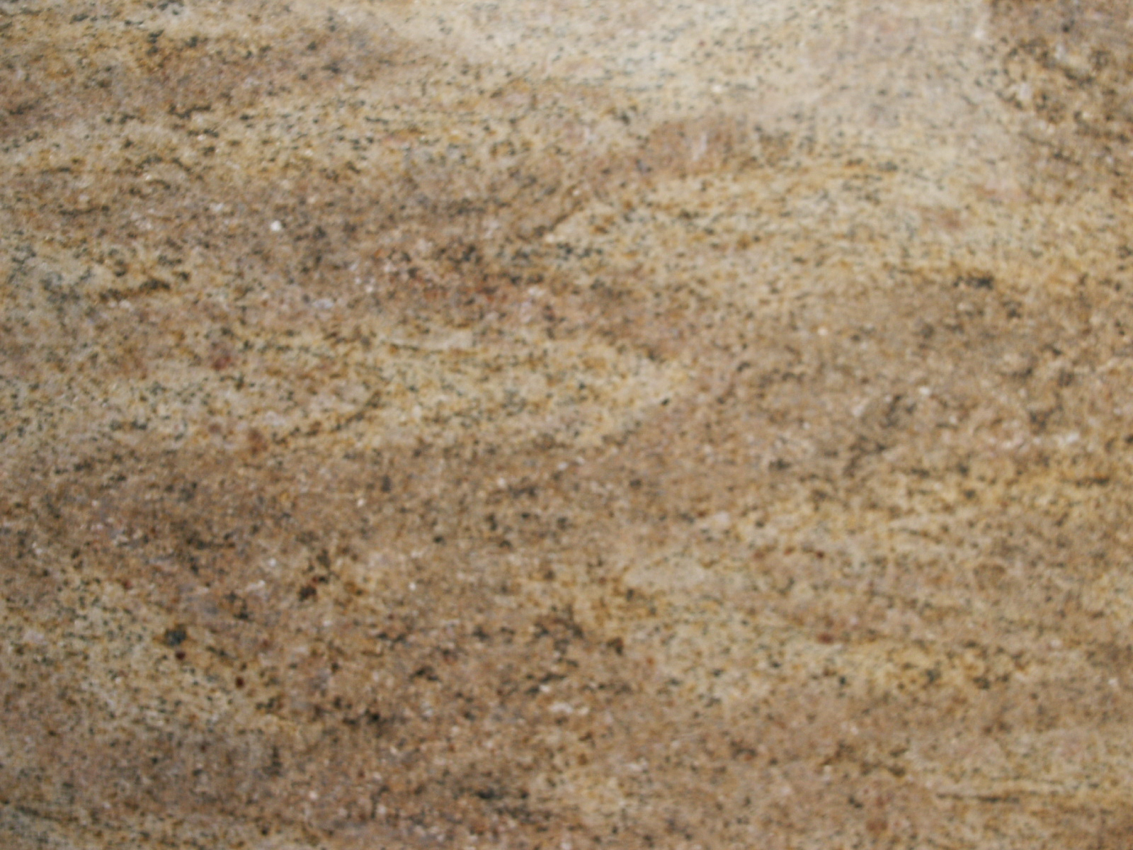 A Very Popular Mid Priced, Light Golden Coloured Indian Granite With Black  And Coloured Flecks. Suitable For Floors, Walls And Worktops.